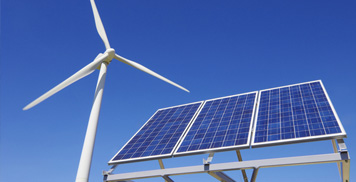 Photo of a solar panel and a wind turbine